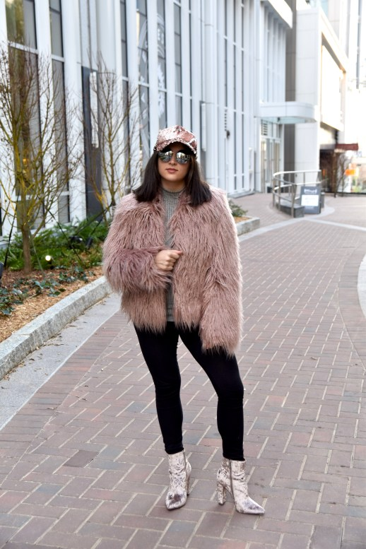Up close photo of Dania wearing sequin hat and pink faux fur coat