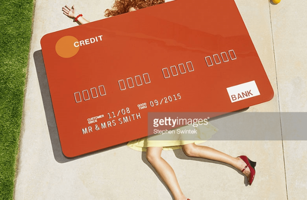 INTJs are planned spenders.|INTJ General Shopping Habits. Credit: Stephen Swintek Woman crushed by credit card