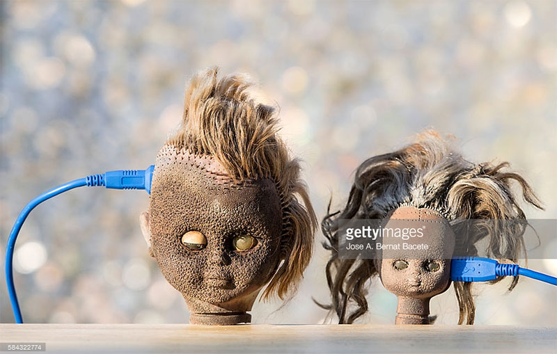 Two doll heads. Photo Credit: Jose A. Bernat Baceta - 584322774 via gettyimages.com