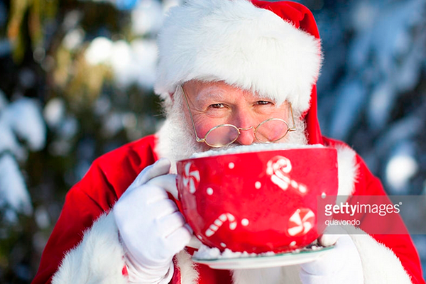 Santa Sipping Cocoa. Photo Credit: Quavondo. Gettyimages. Introvert Guide to Hosting the Family Celebration. Alwaysuttori.com.