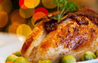 roast chicken dinner with peas and carrots