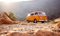 orange kombi van in rugged terrain