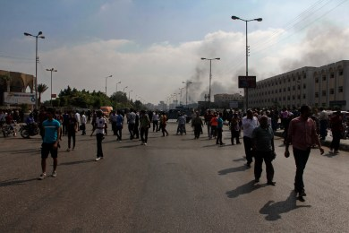 People gathered around police forces to watch the evacuation of Rabaa-Adawiya sit in