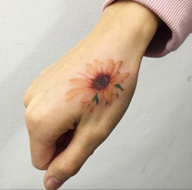 Supremely-Soft-And-Delicate-Hand-Piece Amazing Sunflower Tattoo Ideas