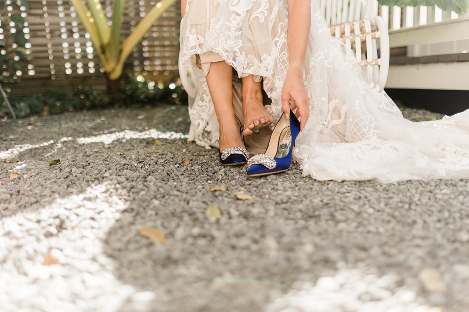 Bride putting on her navy shoes