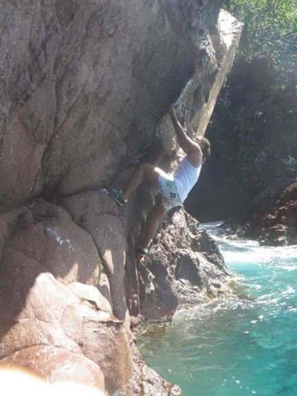 Freehand rock climbing in Grande Anse, Martinique