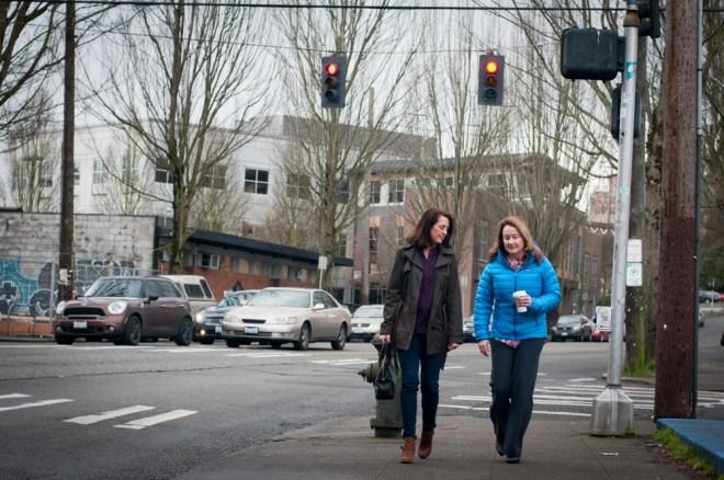 Carol walks with Lori after purchasing a tea at Starbucks.