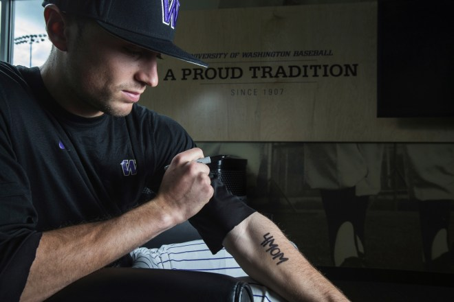 Husky outfielder Braden Bishop honors his mother each time he take the field, writing on his forearm