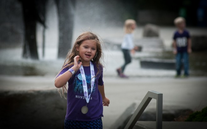 Children play at the fountain on Seattle University's campus during the Walk to End Alzheimer's.