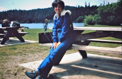 A woman sitting in a picnic bench