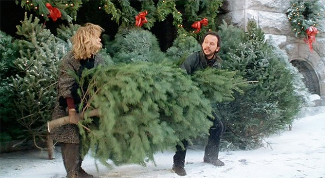 Meg Ryan and Billy Crystal carry a large Christmas Tree in When Harry Met Sally.