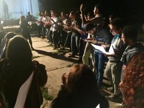"""The boys sing, """"Du el gites te aghjik es, De hoy na na, nay na nay"""""""