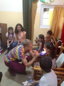 Dr. Barb Tashjian checking the teeth of children.