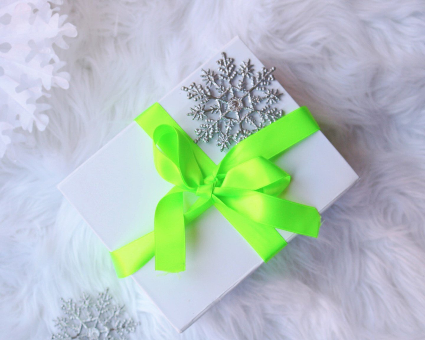 Arbonne gift wrapped hair and body wash in a white box and green silk ribbon