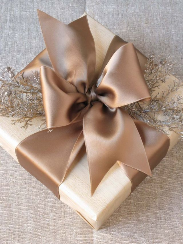 I love the wood grain paper & satin bow - still pretty with or without the extra embellishment!