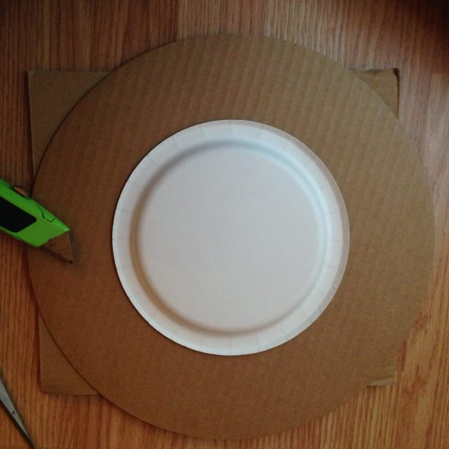I traced a small paper plate in the center of the cardboard to be cut out