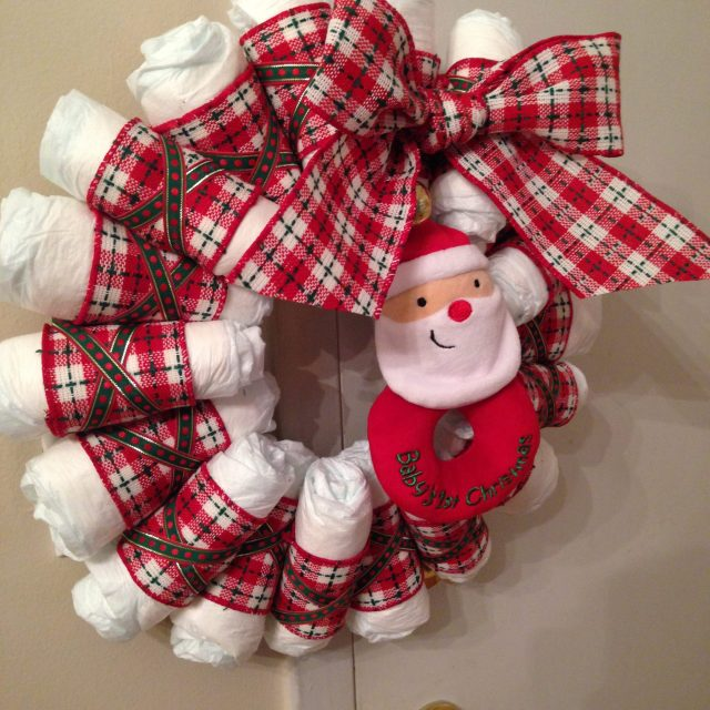 Make a bow out of the big ribbon & ta-da! I bought a santa teether/rattle to hang in the middle :)