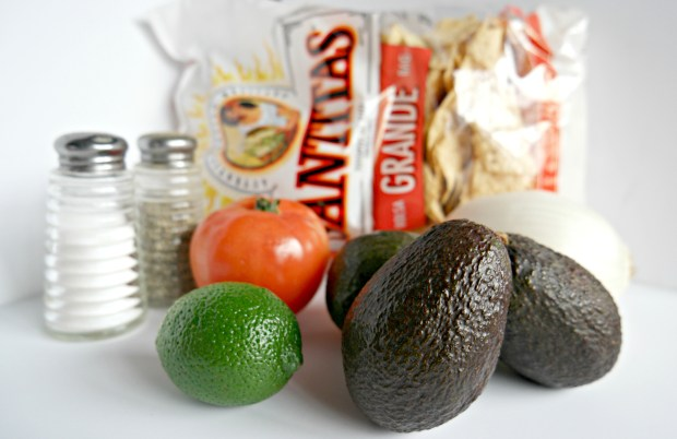 WHAT YOU'LL NEED: 3 avocados, 1 tomato, 1 onion, 1 lime, salt + pepper, tortilla chips