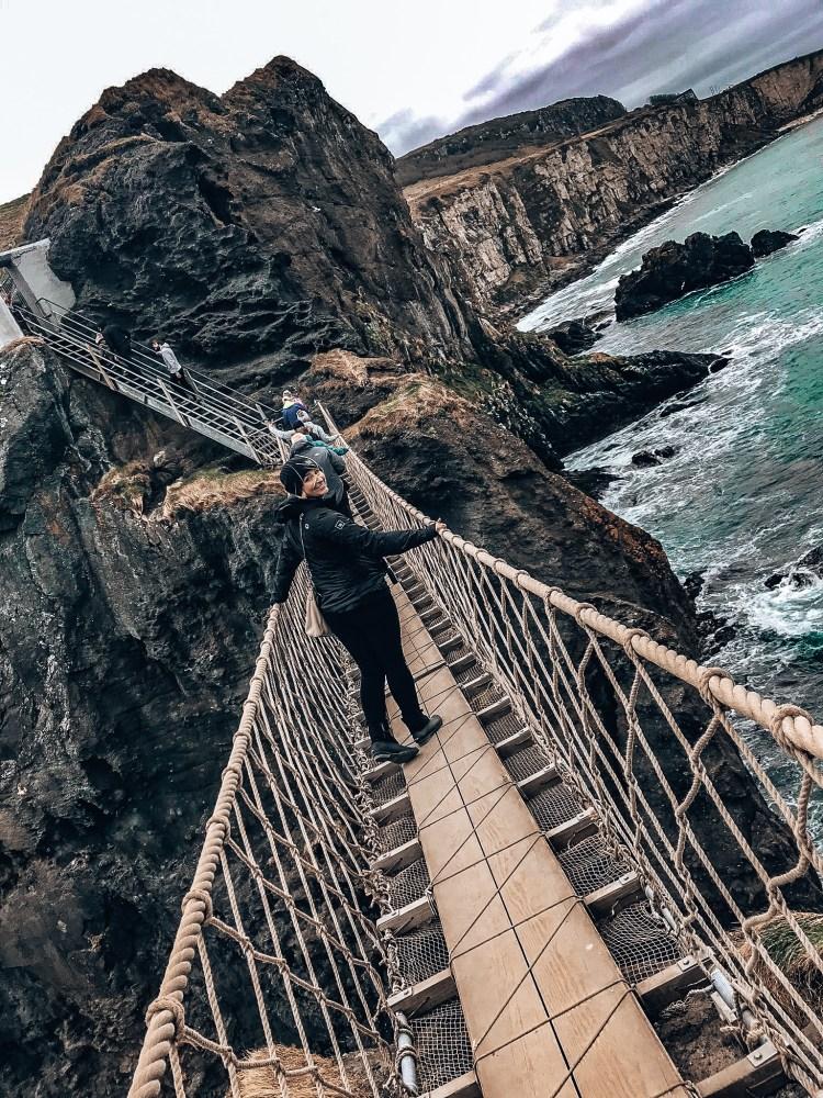 Woman walking on Carrick-a-Rede Bridge