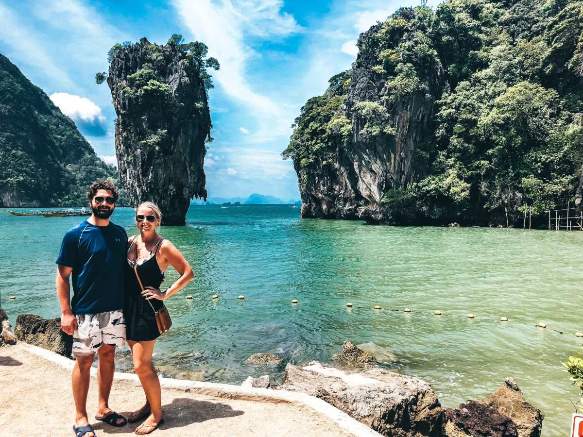 Man and woman standing in front of James Bond Island