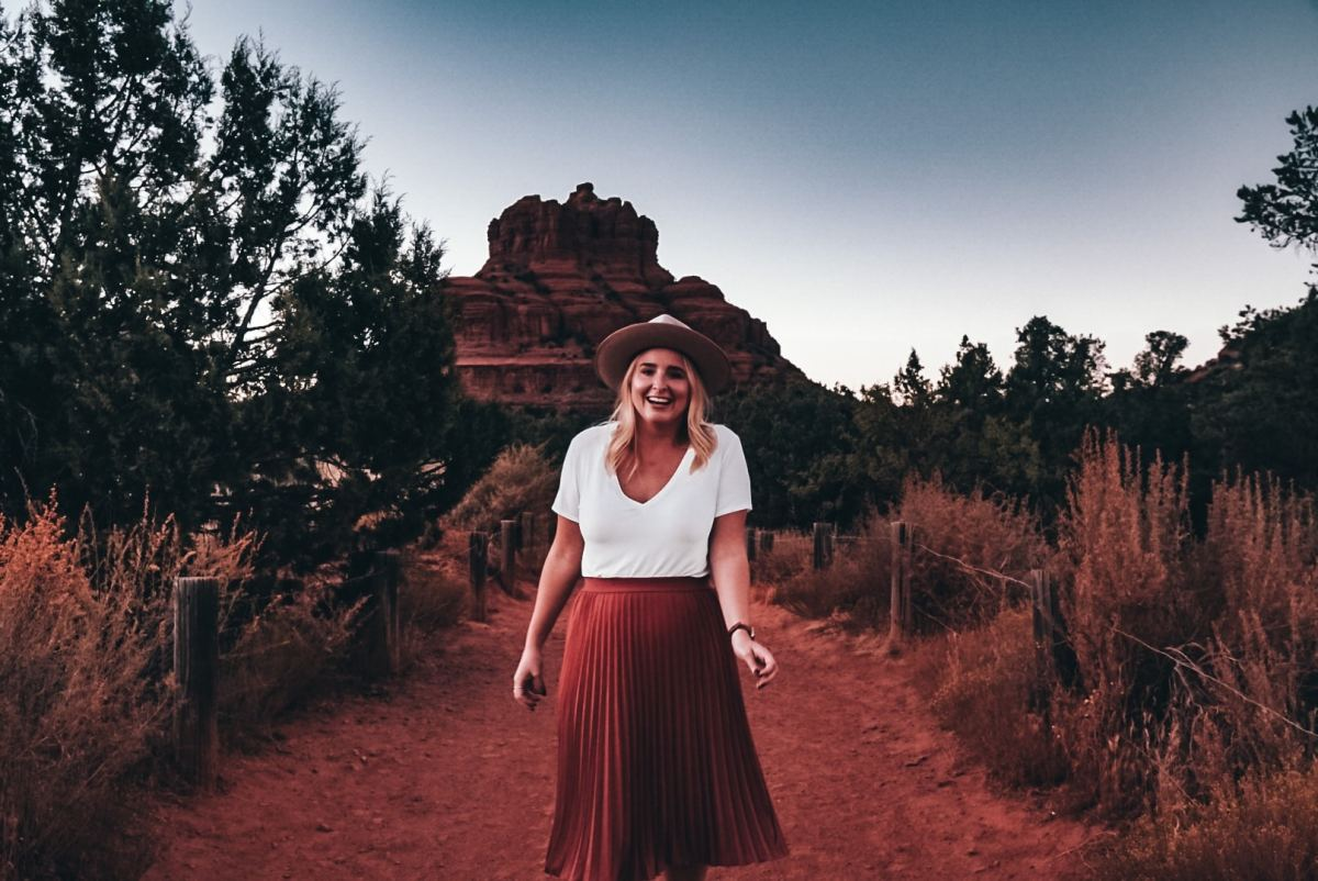 Woman in front of Bell Rock in Sedona