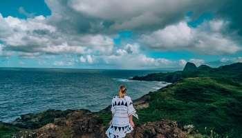 Woman sitting on the rocks on Ohai Loop Trail