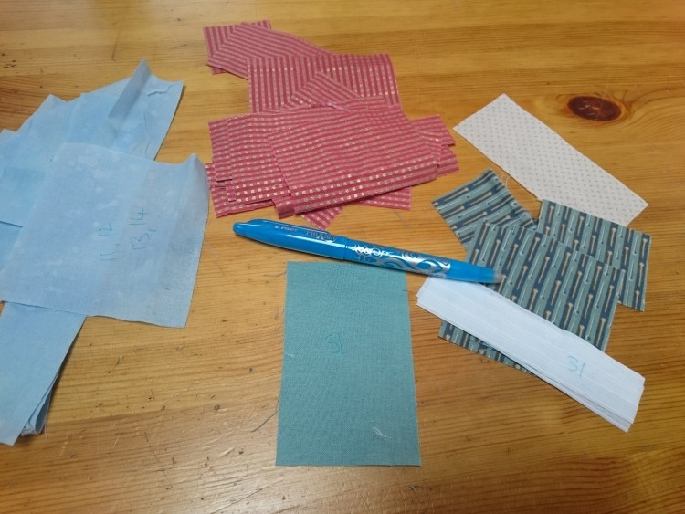 Cut pieces for Happy House block.JPG