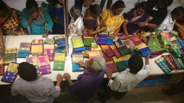 customers buying sari fabric in Chennai