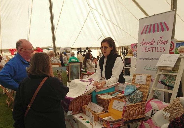 Talking to customers at the Wolsingham Show, 2019