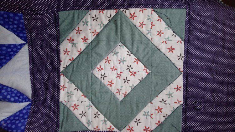 A quilt block, showing how it has been quilted