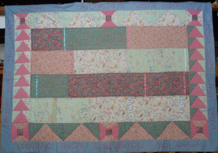 A hand-made quilted panel by Amanda Jane Ogden in pinks and blues, with hand quilting and hand embroidery