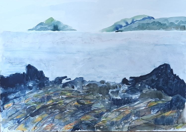 A painting in watercolour by Amanda Jane Ogden depicting a rocky foreshore, the sea and another coast in the distance