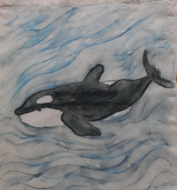 an orca swimming in the sea, created using Inktense fabric pencils
