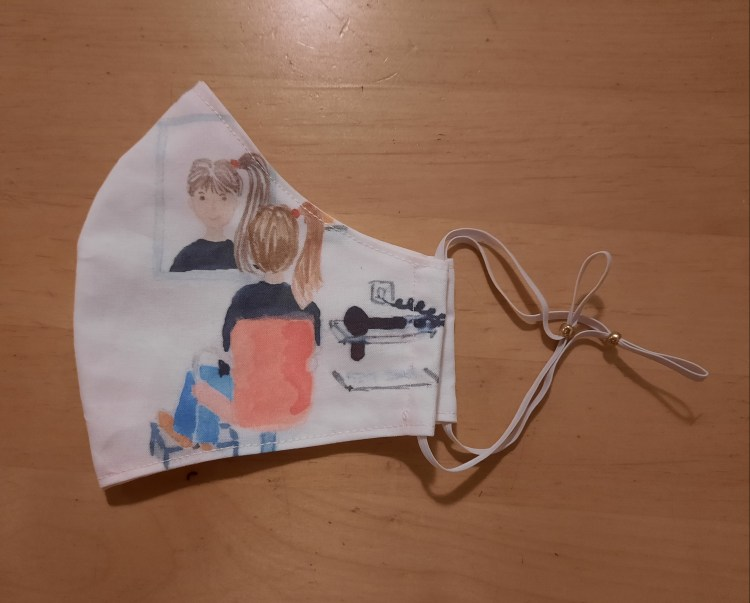 The right hand side of the finished mask showing a girl in a hairdresser's chair