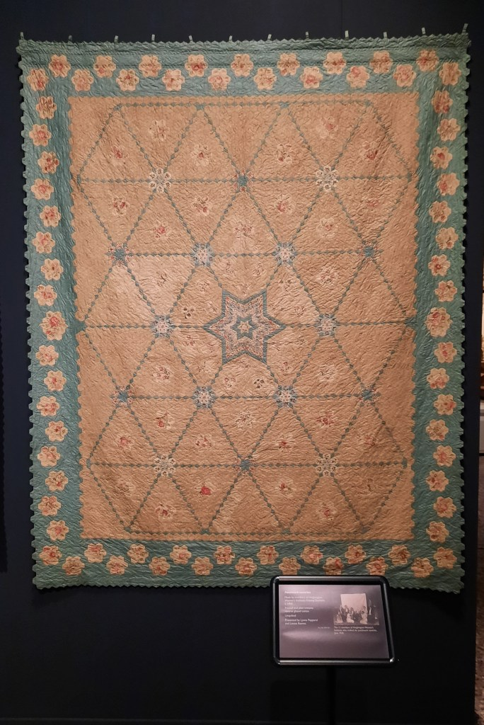 Cream and turquoise blue patchwork coverlet made by Heighington Women's Institute c 1935