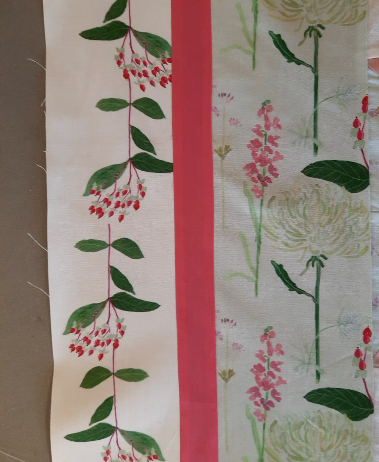 The outer border on the left side of the 'Summer Bouquets' quilt, the outer border uses the 'Berries on White' fabric design which is of red berries in a sprig with green leaves