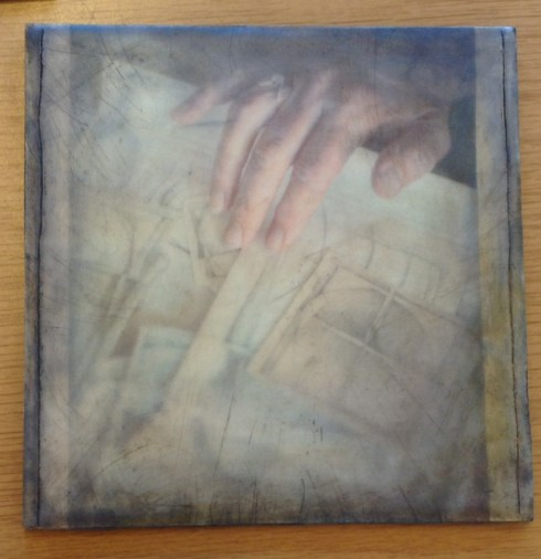 Encaustic photography by Doug Loates, capturing Carol's hand with her precious Pencil Prayers.