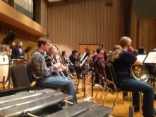The brass row waits to play.