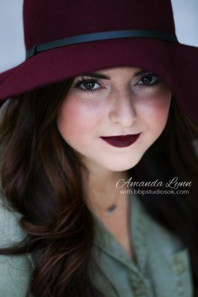 high school senior wearing maroon floppy hat looking at camera oklahoma city
