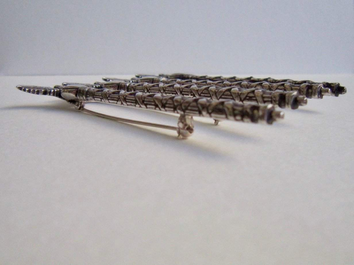 Side view of 4 Mace of the Republic pins.