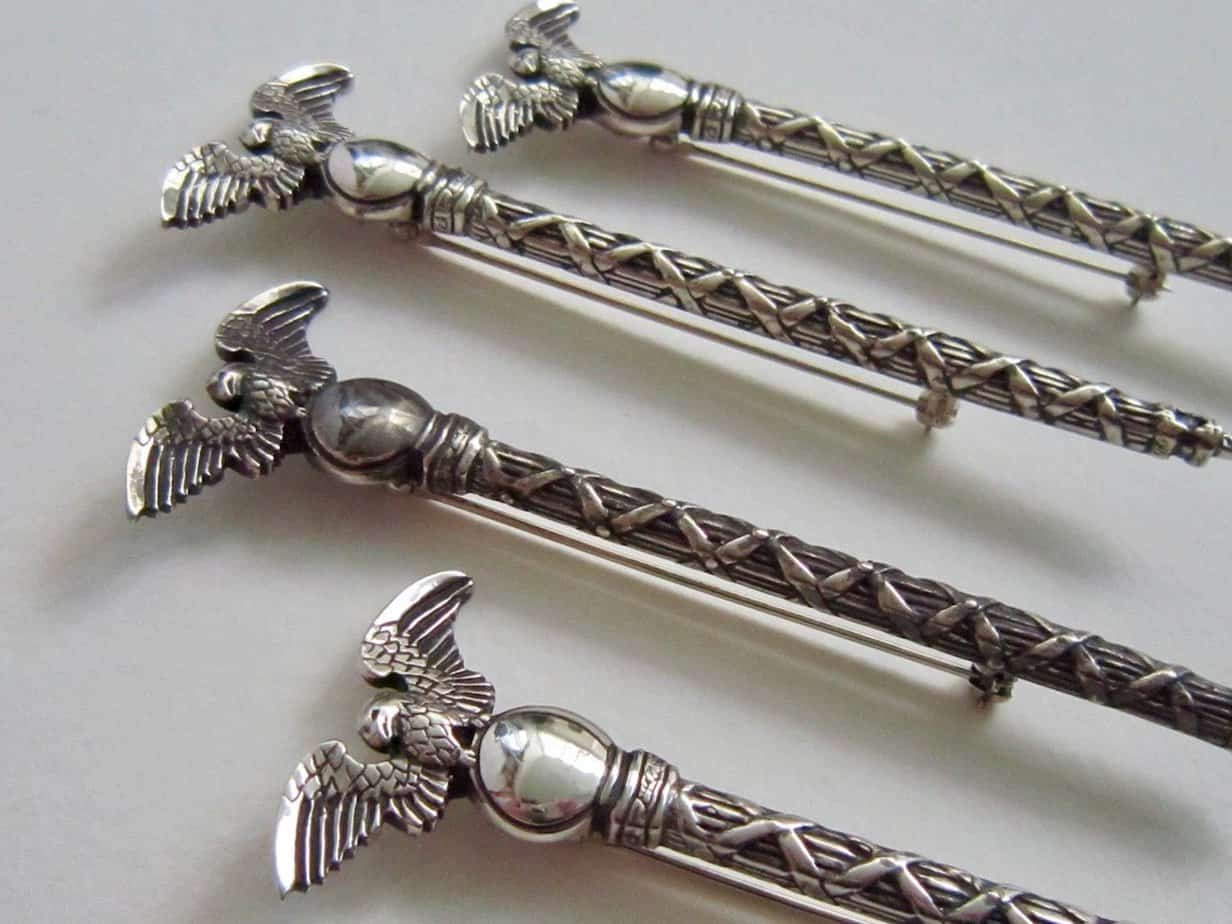 4 hand carved silver Mace of the Republic pins.