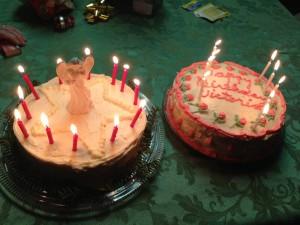 My homemade birthday cake next to her birthday cake for Jesus.