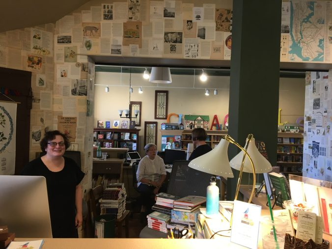 My gracious hosts at Appletree Books. Notice the book wallpaper behind the counter.