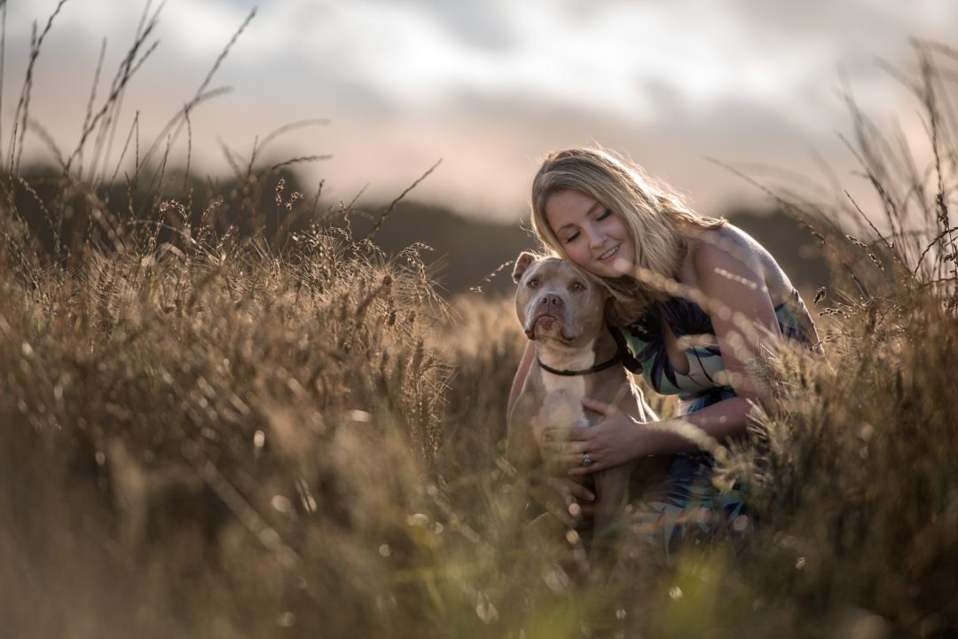 staffy dog woman blonde portrait