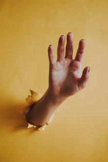 hand breaking through wall