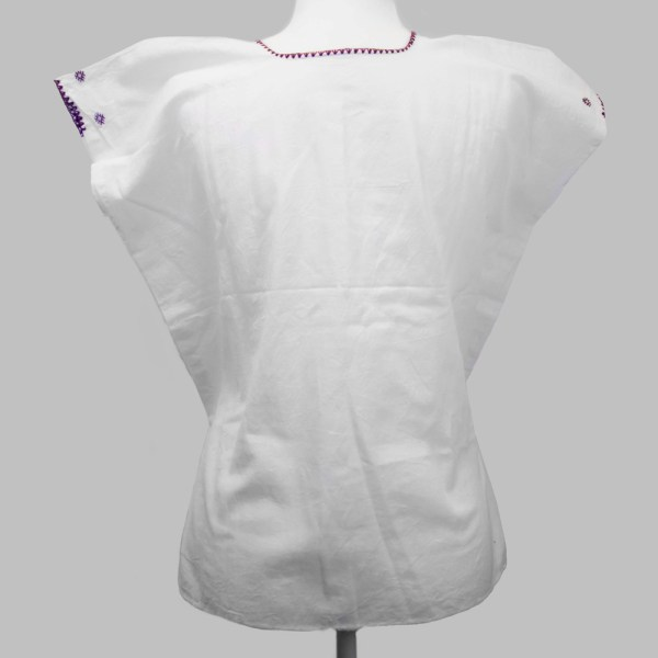 Back view Traditional handmade Mexican embroidered white blouse made of cotton on a mannequin