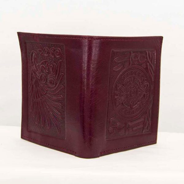 Close up of a Mexican red wine handtooled leather wallet for men for sale at amantli.com with aztec calendar