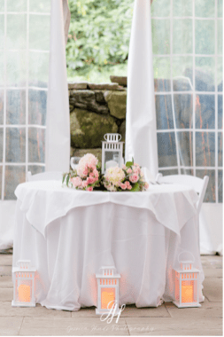 amy and michael reception table flower photo lantern Amaranth Florist wedding