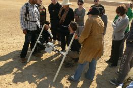 Geophysics field school: And whilst geophysical survey has never been a substantial part of the fieldwork program at Amarna, the ruins of the city being relatively clear from the surface, between 2009 and 2011 sample areas of the city were surveyed using a variety of electronic equipment (provided through the University of Arkansas) which recorded buried features. Here Jason Herrmann demonstrates, to a group of students and trainees, the use of a magnetometer.