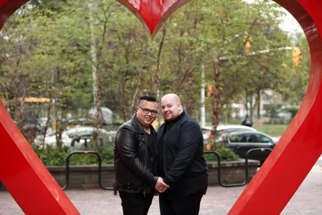 Pedro and Mark in a giant red heart